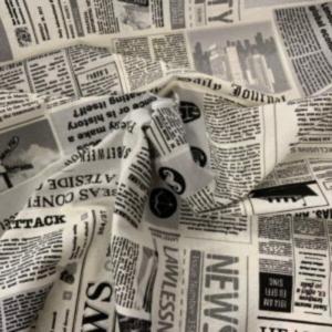 Decoratie stof krantenknipsel print